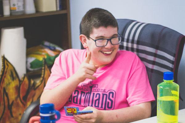 boy smiling at desk